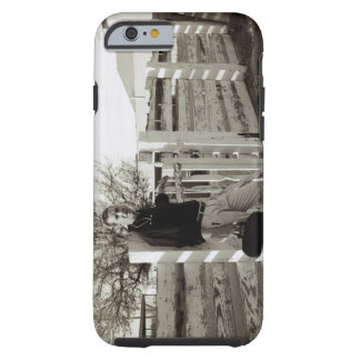Doctor Standing by a Fence Tough iPhone 6 Case