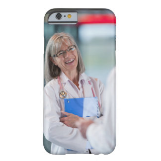 Doctors talking together in hospital hallway barely there iPhone 6 case