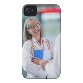 Doctors talking together in hospital hallway Case-Mate iPhone 4 case