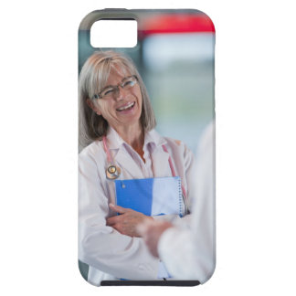 Doctors talking together in hospital hallway iPhone 5 covers