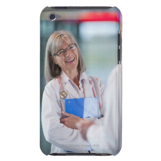 Doctors talking together in hospital hallway iPod touch cover