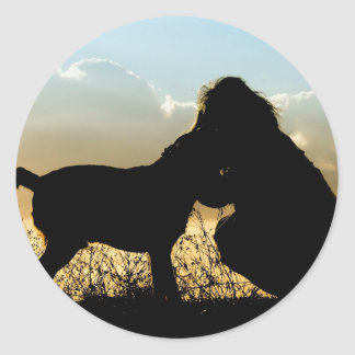 Dog and Woman Sunset Silhouette Round Sticker