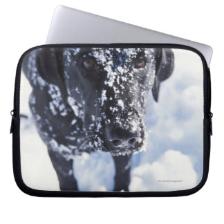 Dog covered in snow laptop sleeve