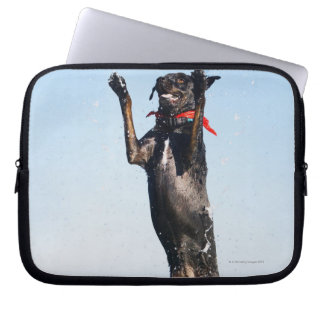 Dog jumping in water laptop sleeve