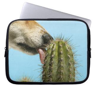 Dog licking cactus, close-up laptop sleeve