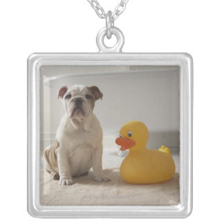 Dog on mat with plastic duck silver plated necklace