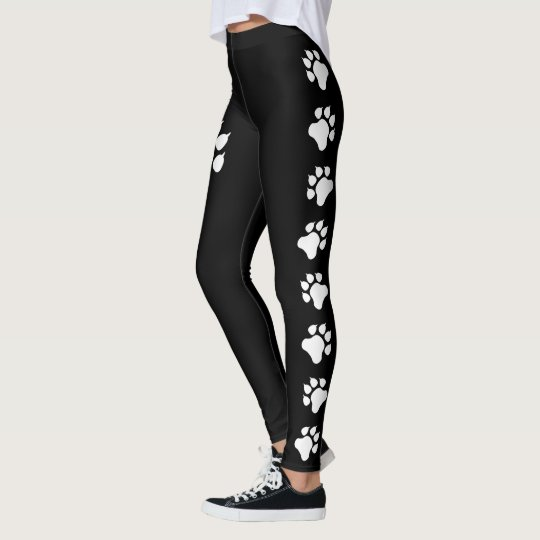 Dog Paw Print Silhouettes In Black And White
