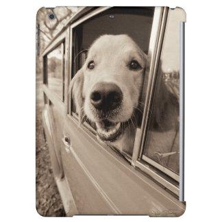 Dog Peeking Out a Car Window
