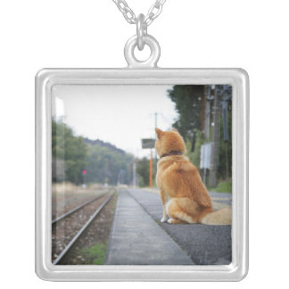 Dog sitting on train station silver plated necklace