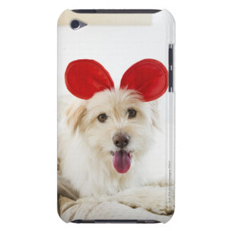 Dog wearing toy ears on bed barely there iPod covers