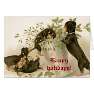 Dogs playing with Christmas mistletoe & holy berry Greeting Card