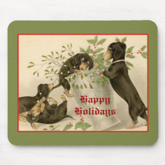 Dogs playing with Christmas mistletoe & holy berry Mouse Pad
