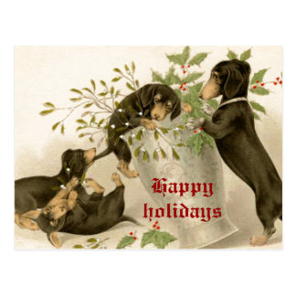 Dogs playing with Christmas mistletoe & holy berry Postcard