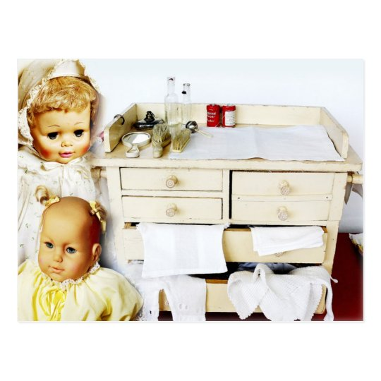 Dolls and vintage changing table postcard