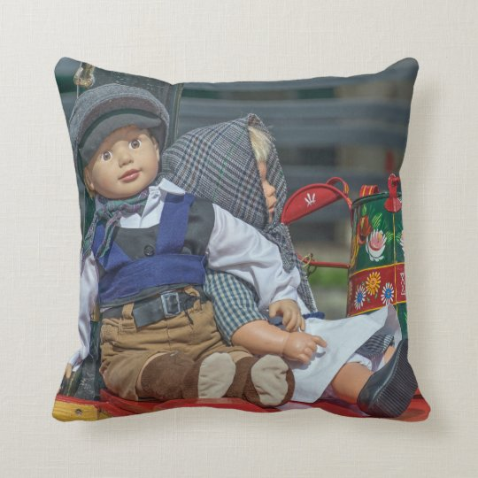 Dolls and watering can throw cushion