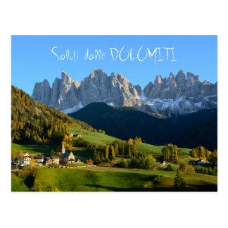 Dolomites village in fall 'saluti' postcard