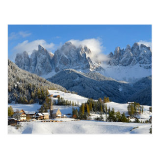 Dolomites village in winter postcard