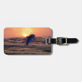 Dolphin at sunset luggage tag