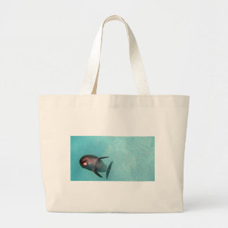 dolphin in the sea tote bag