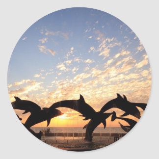 Dolphin s jumping from the water at sunset stickers