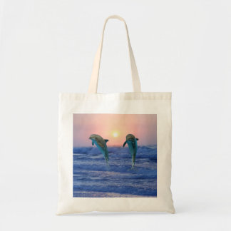 Dolphins at sunrise tote bag