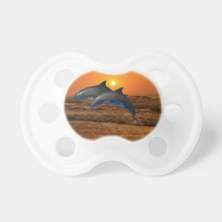 Dolphins at sunset baby pacifier