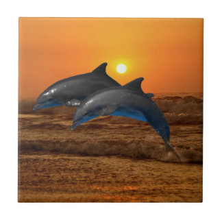 Dolphins at sunset small square tile