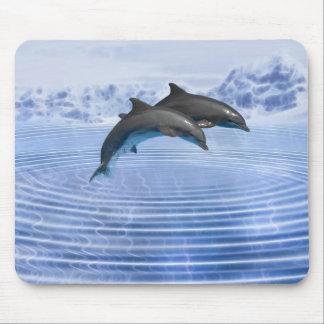 Dolphins in the clear blue sea mouse mat