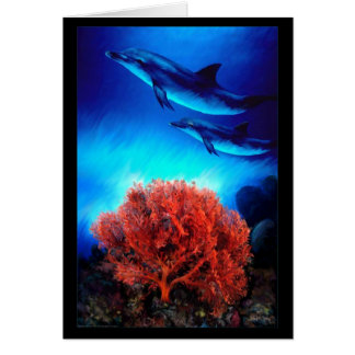 Dolphins over corals greeting card