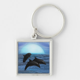 Dolphins playing at moonlight key ring