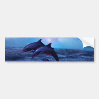 Dolphins playing in the ocean bumper sticker