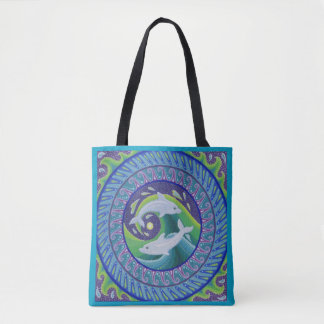 Dolphins playing in the waves tote bag