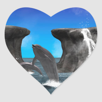 Dolphins swim and jumping in the sea heart sticker