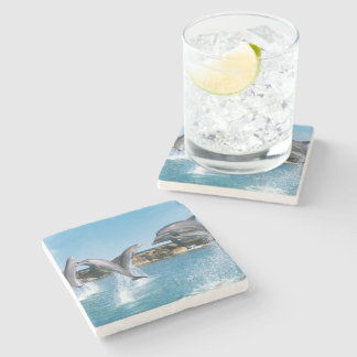 Dolphins swimming and doing tricks in the ocean stone coaster