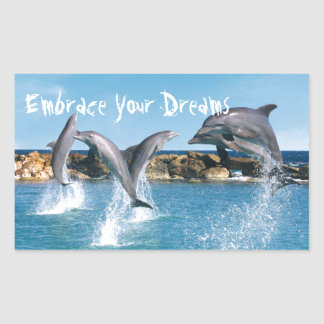Dolphins swimming and doing tricks rectangular sticker