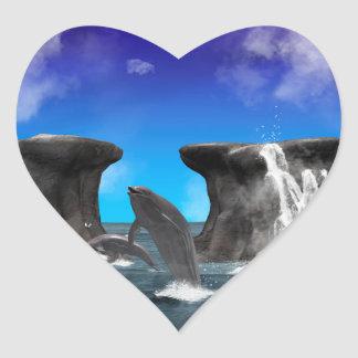 Dolphins swimming and jumping heart sticker