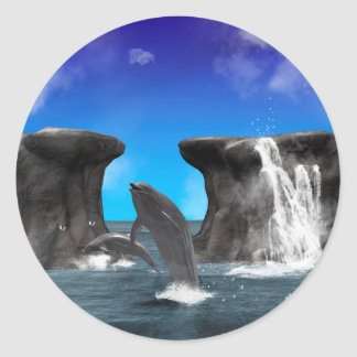 Dolphins swimming and jumping round sticker