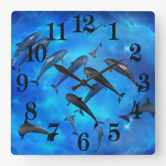 Dolphins swimming in the ocean clocks