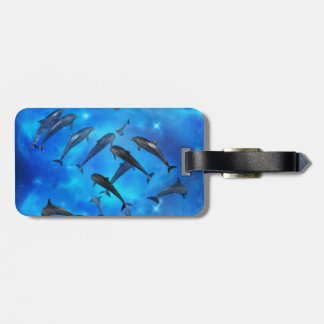 Dolphins swimming in the ocean luggage tag