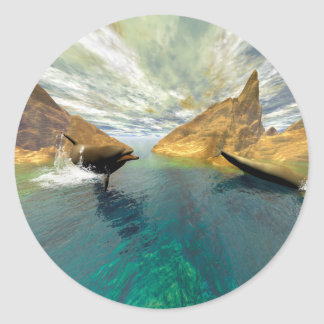 Dolphins swimming round sticker