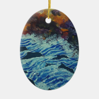 Dolphins under storm clouds ceramic oval decoration