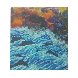 Dolphins under storm clouds notepad