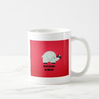 Don't forget to floss! coffee mug