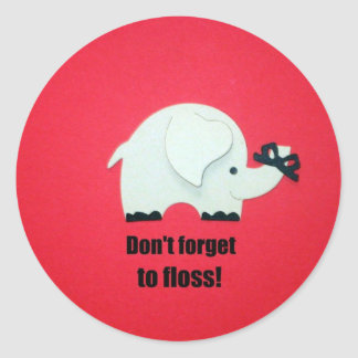 Don't forget to floss! round sticker