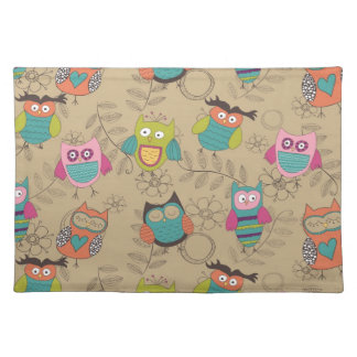Doodled owls on beige background placemat