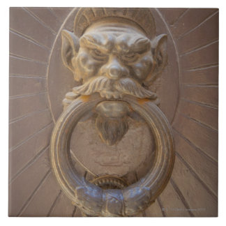 Door knocker in Siena, Italy. Tile