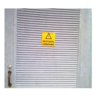 Door with danger warning on photo