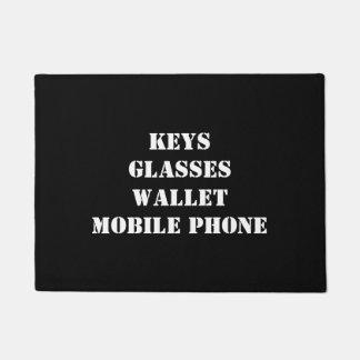 Doormat with keys, glasses, mobile phone, wallet