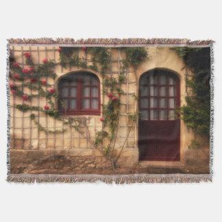 Doorway of rose cottage throw blanket