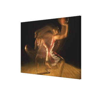 Double exposure of woman playing basketball canvas print